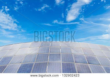 Solar panels against blue sky backgrounduseful for carbon credits concept.