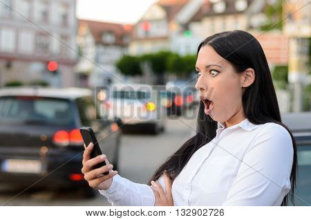 Astonished Woman Reading An Sms On Her Mobile