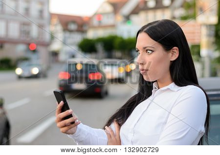 Incredulous Woman Reading A Message On A Mobile