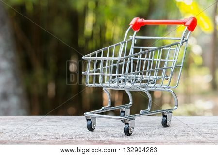 the model shopping trolley on the wood