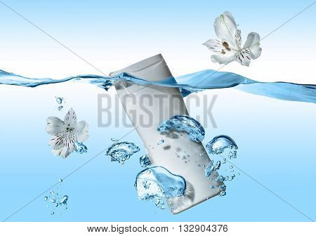The bottle of cosmetic milk, cosmetic cream, cosmetic water in the blue water wave with splash and  big air bubbles  and with two white flowers near the bottle