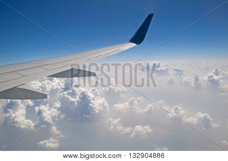 The view from the plane of the cloud vertical formation over the Himalaya mountains, Nepal
