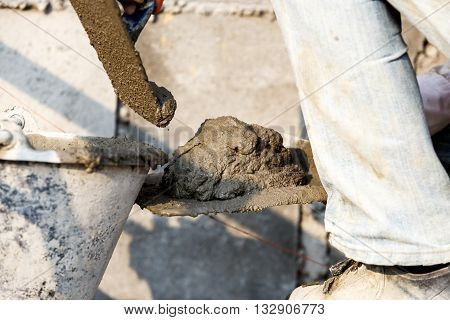 Plasterer Concrete Worker At Wall Of House Construction