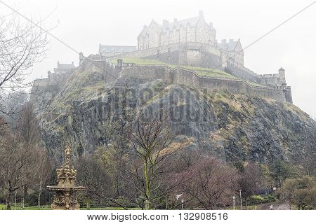 A typical rainy day in Edinburgh with the castle covered in mist in the background.