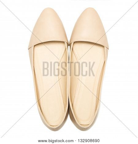 Beige female shoes, isolated on white background. top view