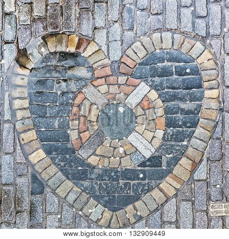 The Heart of Midlothian built into the cobblestones of Edinburgh's Royal Mile in the nineteenth century. It is considered good luck to spit on the heart as you pass.