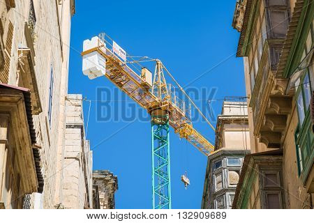 From the streets and alleys of Valletta Malta - Reconstruction of buildings in the old town.