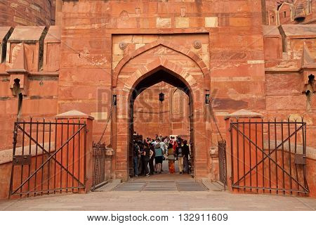 AGRA, INDIA - NOVEMBER 29, 2015: Entrance to the historical Red Fort of Agra - a UNESCO world heritage site - with visiting tourists