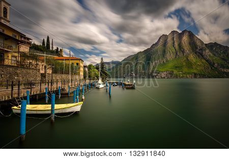 Harbor of Riva di Solto on Iseo Lake with mountains on background Italy