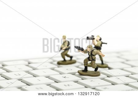 computer keyboard army men on white background