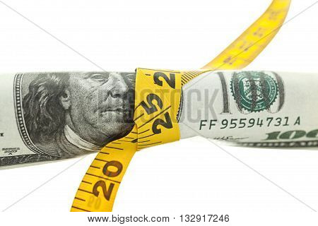 dollars roll in the measuring tape on white background