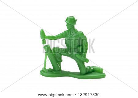 green plastic toy soldier on white background