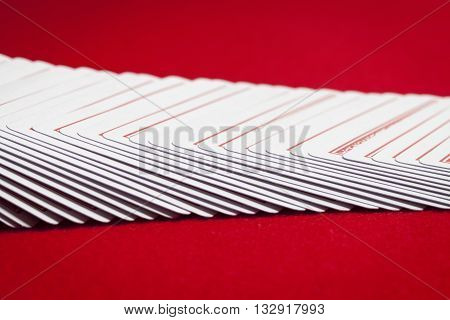 poker card settled on table isolated on red background