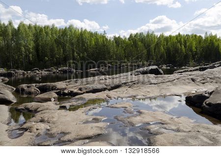 Stone polished and shaped by water in a drained river in the North of Sweden.