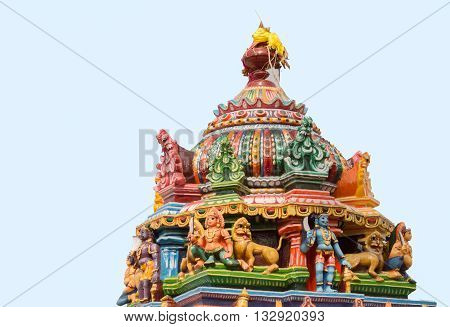Chettinad India - October 17 2013: Statue of Ayyanar and lions on colorful Vimanam of Mariamman temple in Kothamargalam. He defends the village.