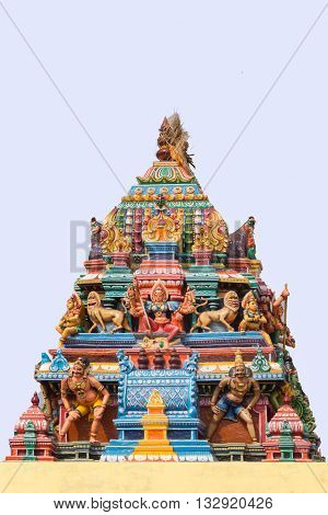 Chettinad India - October 17 2013: Statue of Devi Durga and lions on colorful Vimanam of Mariamman temple in Kothamargalam. She represents female power.