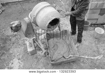 cement mixer at a construction site. black and white photo