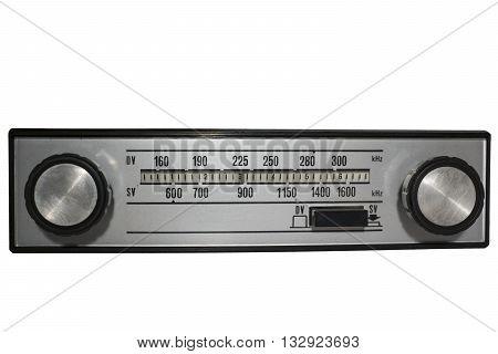 Vintage auto radio over isolated white background.