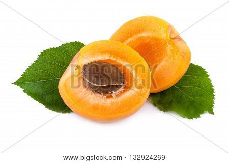 Fresh apricots with leaves on white closeup.