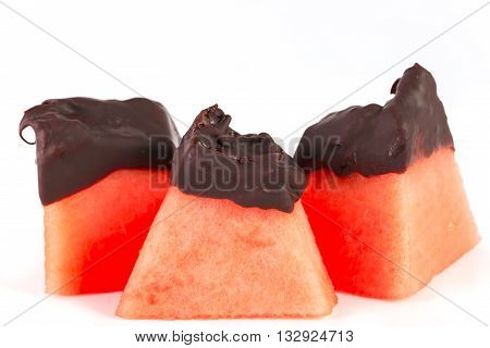 sliced of melon whit chocolate on white background