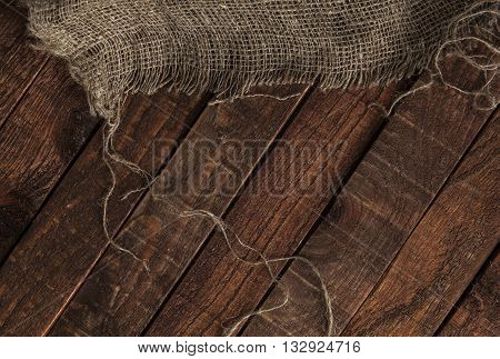 jute texture on wooden table background. Wooden table with sacking