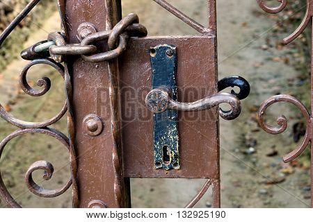 old locked gate with lock. secret, iron