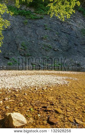 Sandbank on a mountain river with rocky shores