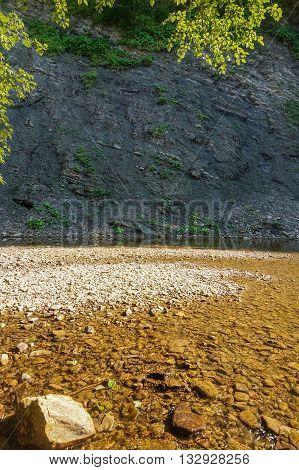Sandbank on a mountain river with rocky shores