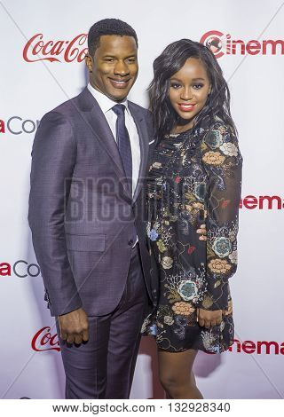 LAS VEGAS - APRIL 14 : Director Nate Parker (L) recipient of the Breakthrough Director of the Year Award and actress Aja Naomi King attend the CinemaCon Big Screen Achievement Awards at The Caesars Palace on April 14 2016 in Las Vegas
