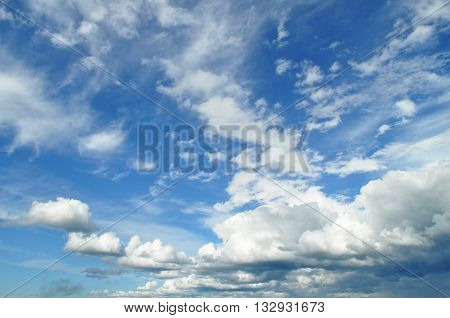 Bright blue sky and big white cloud background