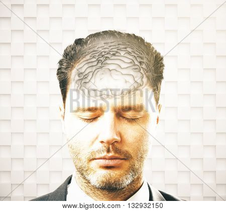 Brainstorming concept with businessman and abstract grey brain on patterned background