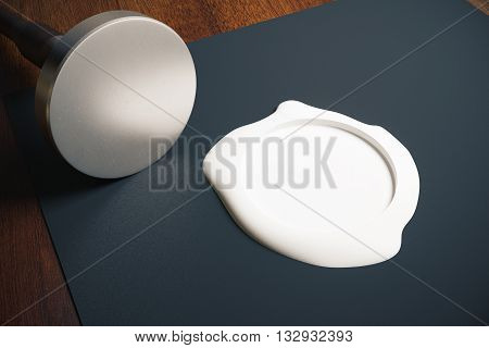 Black paper sheet with blank silver stamper and white seal on wooden background. Mock up 3D Rendering