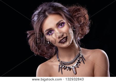 The face of a beautiful woman . Perfect make-up . Beauty fashion . Eyelashes. Cosmetics Eyeshadow . Model with dark hair and dressing.