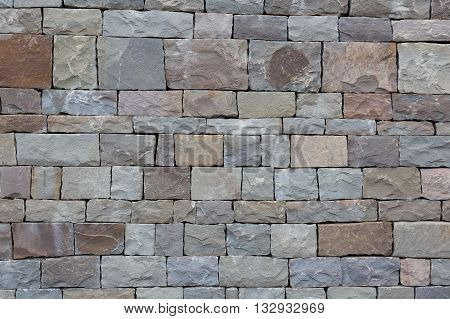 Stone wall texture background natural color traditional Chechen masonry.