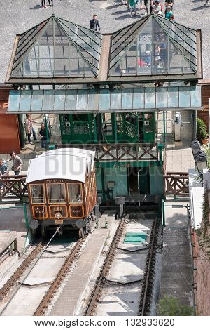 Budapest Hungary - CIRCA May 2016: Funicular full of people traverse a hill