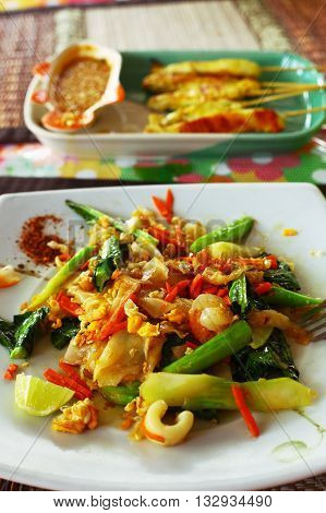 spicy thai chicken in curry with vegetables and pepper peanut sauce