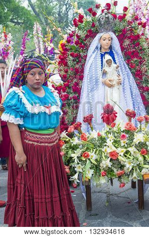 PANCHIMALCO EL SALVADOR - MAY 08 : Salvadoran woman participate in the procession of the Flower & Palm Festival in Panchimalco El Salvador on May 08 2016