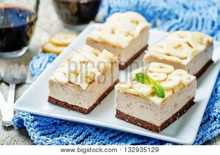 chocolate banana mousse cake on wooden background