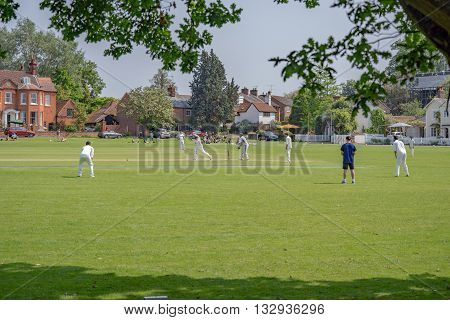 Hartley Wintney, HAMPSHIRE/UK- JUNE 5TH 2016 :Village cricket being played at Hartley Wintney in Hampshireon June 5th 2016. Unidentified people.
