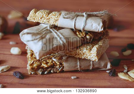 Vegetarian sweets. Granola bars made of sesame seeds peanuts cashew nuts sunflowers seeds oil and honey.