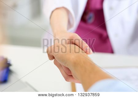 Female Medicine Doctor Shake Hand As Hello With Male Patient