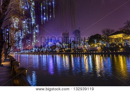 Grand Canal Buildings Lights NIght Reflection Hangzhou Reflection Zhejiang China. Created 500s AD the oldest and longest canal from Hangzzhou to China over 1000 miles.