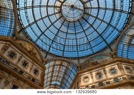 Milan Italy - May 25 2016: view of the glass roof and upper floors Galleria Vittorio Emanuele II. The gallery was designed by the architect Giuseppe Mengoni in the 1865-1877 biennium.