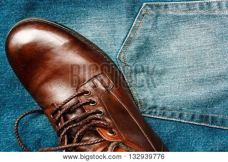 Jeans with brown leather boot shooted overhead