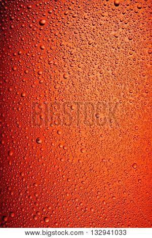 Texture water drops on the brown bottle of beer. Macro shot