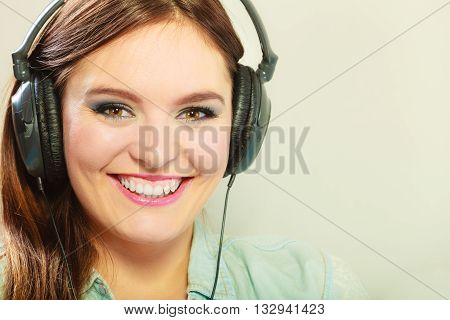 People leisure relax concept. Closeup happy woman big headphones listening music mp3 relaxing