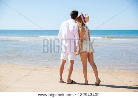 Couple Enjoying A Walk At The Beach Together