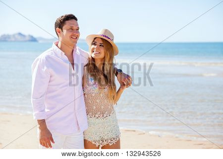 Couple In Love Walking By The Beach