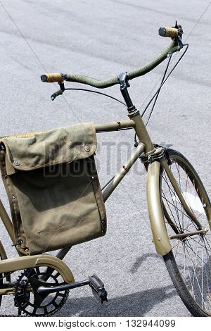 army olive drab painted bicycle with bag