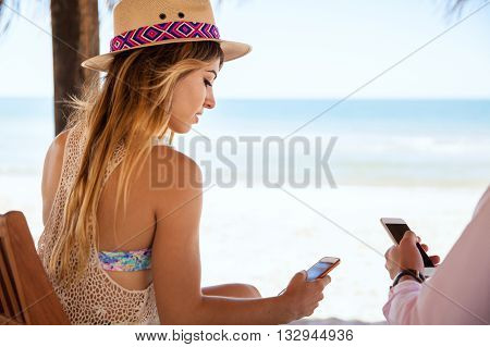Woman Using A Smartphone On Vacation